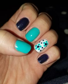 Turquoise and navy gel nails with flower accent