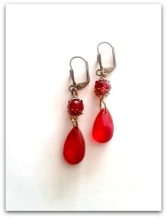 Garnet red crystal glass teardrop earrings with bronze accents. 25$
