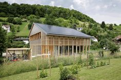 HHF architects has completed 'house C', a two-storey residence built for a family of five in ziefen, a village near basel, switzerland.