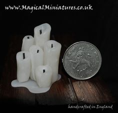 Group of 1:12th scale melting candles standing in a pool of melted wax. Just 3cms high. Perfect for a Tudor/Medieval dollshouse.
