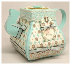 Paper Teapot - you can purchase the template and instructions! My mom would go bananas for this :)
