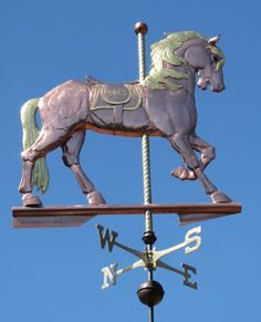 Our basic Carousel Horse Weathervane harkens back to a history that began with knights in armor riding in circles and throwing balls between themselves as practice for combat. We also make a Deluxe Carousel Horse Weathervane with classic armor, drape, and gilding. The horse has glass eyes, and optional gold leaf to emphasize the stylized motion …