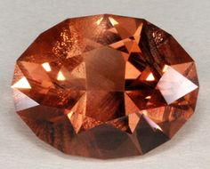 Beautiful richly-colored oval faceted sunstone.