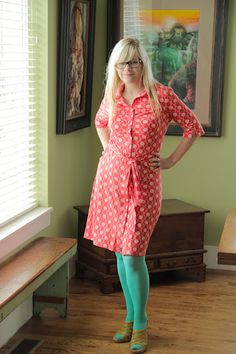 coral red dress, turquoise tights, yellow shoes