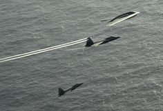 B-2 Spirit with Two F-22 Raptors in Right Echelon Tow