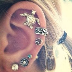 Cute earrings! These make me consider getting more ear pearcings! #rocktheyear #butterlondon