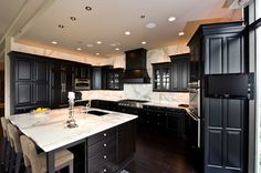 Best 12 Awesome Black Kitchen Cabinets : White Carrara Traditional Kitchen With Black Cabinets Design Black Kitchen Cabinets, Kitchen Cabinet Design, Black Kitchens, Home Kitchens, White Cabinets, Kitchen Black, Wood Cabinets, Kitchen Cabinetry, Kitchen With Dark Floors