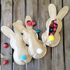 This little bunnies are made of craft paper. I sew them and fill them with candies! A pom pom is used for a cute tail.