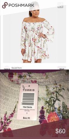 Torrid floral smock bell sleeve dress Torrid flock bell sleeve dress. Size 1 (16). Worn off shoulders or on shoulders. torrid Dresses
