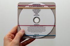 Cardboard & rubber bands as CD packaging - so simple I can't help but love it! — Packaging of the World: Homentage a la Cinta Meravella