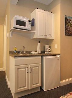 Tiny motel kitchenette. All I need.                                                                                                                                                                                 More