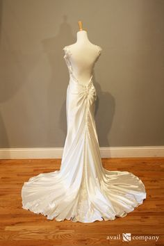 A beautiful gown for spring or fall, made of flowy satin with silver lace and crystals.  A sexy style perfect for a beach or fairy tale wedding.