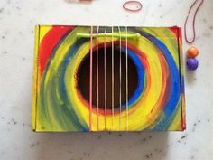 DIY Toy Guitar Box  A terrific craft to do with kids or as a family, make toy guitars! Kids can have fun making musical instruments and then also playing music with them too!