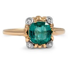 A cushion shaped natural emerald dazzles in this exceptional ring from the 1950's. Four bezel set old European cut diamond accents perfectly frame the center gem in this captivating Retro-era piece (approx. 0.05 total carat weight).