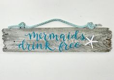 """mermaid sign This adorable """"Mermaids Drink Free"""" driftwood sign is hand-lettered on Maine driftwood. With a resin starfish affixed to the right side of the lettering, this is truly a one- Beach Signs Wooden, Driftwood Signs, Driftwood Wreath, Painted Driftwood, Driftwood Wall Art, Driftwood Crafts, Seashell Crafts, Mermaid Drink, Mermaid Sign"""
