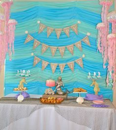 Lovely backdrop at a mermaid  birthday party!  See more party ideas at CatchMyParty.com!