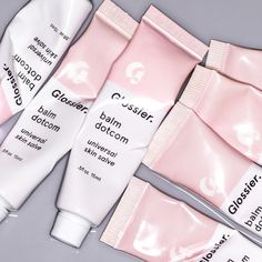 Glossier's 'Balm Dotcom' is everything we need and want in a skin salve. Formulated with natural emollients and antioxidants, this dense all-purpose formula has a waxy texture that will seal in moisture. It can be used to soothe rough areas, as a primer for lipsticks or as a dewy highlighter on your cheeks and eyelids. Shop it now at NET-A-PORTER