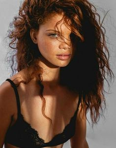 OK BEAUTIFUL...Black model with red hair/freckles. So unique/gorgeous...Carmen Lee Solomons
