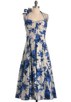retro, feminine, blue floral halter dress. Note the bow detailing just behind the right shoulder...... mmmm :)