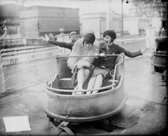 """Two young women at Chicago's White City amusement park, - (© Chicago Daily News negatives collection; courtesy of the Chicago Historical Society) - (bumper cars, flappers, vintage lady, roaring photo)"