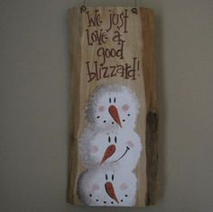 We just love a good blizzard, stacked snowmen, rustic wood.  via Etsy.