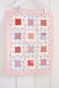 cute baby quilt in pinks and reds