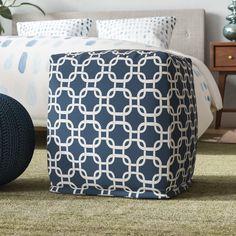 Crafted from weather-treated polyester inside and out, this eye-catching ottoman lets you kick your feet up indoors or out. Made in the USA, it takes on a cube silhouette measuring 17'' H x 17'' W x 17'' D for use as a footstool, chair, or side table. Plus, it lends style as well with a contemporary link motif in two versatile tones. The manufacturer of this product also provides a 90-day guarantee.