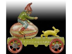 Tin gnome on egg with rabbit penny toy, German