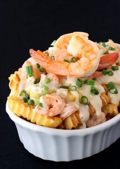 Baked french fries topped with a creamy cheese sauce and shrimp. Fancy done easy!