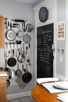 Blackboard paint on pantry door. Regularly used items hanging up. Could be inside the pantry for a less cluttered look.