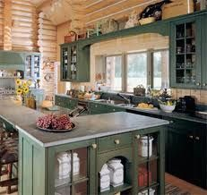 Pine green cabinets go with the woodsy, clean lines of this log home kitchen.
