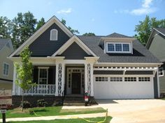 The wooden trim on this porch and above the garage take this house from ordinary to extraordinary!  Located in the neighborhood Carilion near Furman University in Greenville, SC, this new home was built with even more custom details on the inside.