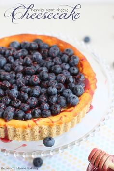 Light and airy, this goat cheese cheesecake from Roxanashomebaking.com is drizzled with berry honey creme and topped with fresh blueberries....