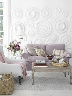 LOVE this wall!!  Great way to add visual interest. :) Ceiling medallions.