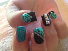 Teal and black leopard nails with square studs and chain