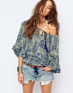 Not fussed on the shorts, but I'm all about that off-the-should blouse!