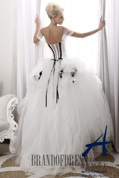 Atelier Aimee Wedding Dress - Style 103  I love the back of this dress with the black corset ties