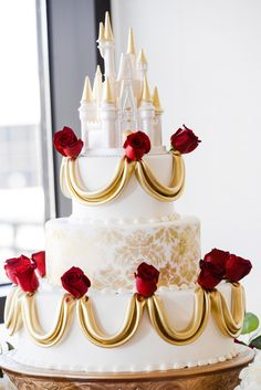 If Princess Belle had a wedding cake we would imagine for it to look a lot like this 3-tiered, gold detailed beauty