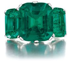 cushion-cut emerald, flanked on either side by two smaller cushion-cut emeralds, single-cut diamond shoulders, mounted in platinum Colombian Emerald Ring, Colombian Emeralds, Emerald Jewelry, Emerald Rings, Ruby Rings, Diamond Rings, Bijoux Art Nouveau, Small Cushions, My Birthstone