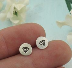 Diamond stud earrings.