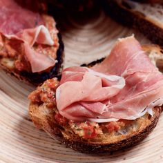 Salty and savory appetizers, like this prosciutto and bruschetta combination, pair well with a variety of wines and cocktailsmaking your gatheringa fl...