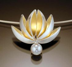 lotus with pearl drop pendant: gold & silver: thea izzi: silver gold & pearl pendant - artful home Lotus Jewelry, Pearl Jewelry, Pendant Jewelry, Jewelry Art, Silver Jewelry, Jewelry Design, Silver Ring, Lotus Necklace, Spoon Jewelry