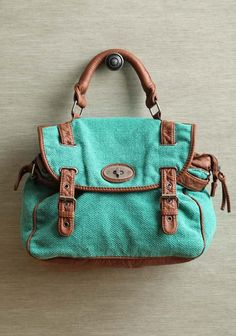 """Visalia Forest Purse 45.99 at shopruche.com. This cotton canvas purse showcases a beautiful mint green accented with chocolate leatherette details. Perfected with antiqued hardware, snap closures, and a large interior compartment. Optional shoulder strap.  Shell: 100% Cotton, Lining: 100% Polyester, 12""""L x 9""""H x 5""""W, 4.5"""" strap drop"""