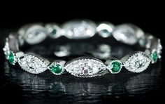 Emerald wedding band...Perhaps an accent to your emerald engagement ring or even to hold its own next to a diamond ring!