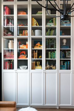 DIY a perfect library with this easy IKEA hack! Floor to ceiling Billy Bookcases that look completely custom without the price tag! Billy Bookcase, Billy Bookcase Hack, Bookcase, Ikea, Ikea Bookshelves, Ikea Billy Bookcase, Built In Bookcase, Ikea Furniture, Ikea Built In