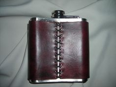 Flask with leather cover/personalized initial. $60.00, via Etsy.