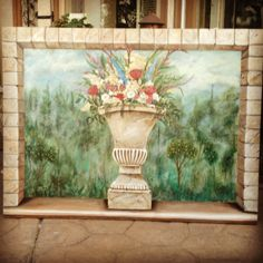Faux stone brick painted with acrylic over a plastered canvas.  Roman garden fresco in background behind a stone urn filled with flowers. 3'x4' ft.  This covered an old ugly 80,s painting of splashed fluorescent paint colors.  I save 1000's of $ recycling old canvas' of bad art