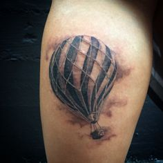 awesome hot hair balloon by Vinny Valdez at black and blue tattoo.