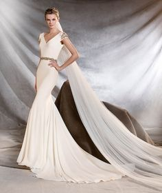 Wedding Dresses, Bridesmaid Dresses, Prom Dresses and Bridal Dresses Pronovias Wedding Dresses - Style Orville [Orville] - Pronovias Wedding Dresses, Advance 2017. Exquisite crepe mermaid wedding dress, fitted to the hips, with a v-neck. A sublime creation that gives a bride a distinguished touch: beautiful gemstone-encrusted sleeves and waist that sculpts the figure.