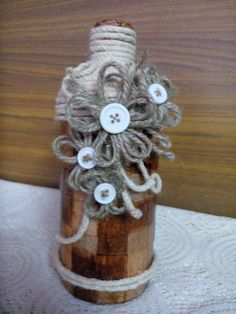 jute bottles can brighten a corner or add charm to your dining table! The base is made of jute coil, embellished with lace, burlap and buttons!   Contact us at +91 9310007286 to place orders for upcycled wine bottles, handmade quilled birthday invites, greeting cards, picture frames and wall hangings.
